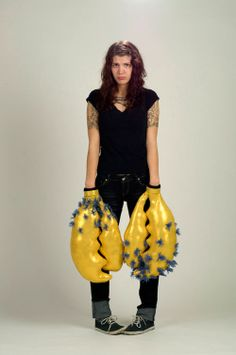 """Rachel Timmins Piece: I Want To Be A Gold Lobster With Blue Puffs 2009 Spandex, wool yarn, polyester stuffing, thread, copper, found gloves 19 x 12 x 4"""" each"""