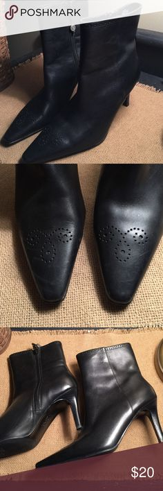 """Women's high heel black leather ankle boots sz. 7 Excellent-worn once, some very minor scuffing, not much noticeable! These are very nice, comfy softer leather black high heel boots. Sz. 7 B these are made by Chaps & they are Chaps """"Dawn"""" style. These zip up on the inside, have a stiletto type high heel (approx. 3 in.) -have a neat front toe design-almost a western small hole punch design, -have a neat zipper pull made of a silver round decal w/Chaps logo. These are more of a just above the…"""
