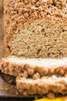 Zucchini Banana Bread with Streusel Topping – Moist, dense, and hearty Banana Zucchini Bread, loaded with spice and brown sugar streusel! This Zucchini Banana Bread with Streusel Topping will actually make you happy that your garden is overgrown with zucchini! It's easy to whip up, and the streusel makes it extraordinarily special! Dan330