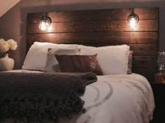 Lisa's rustic DIY wooden headboard freestanding against the wall with her bed in front
