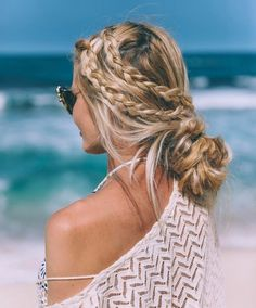 Braided Low Bun    A day at the beach doesn't mean you have to have perfect hair-in fact, we love messy hairstyles for beach day inspiration! Braid a few sections around your head to get your hair out of your face, and then tie the braids in a low bun with the rest of your hair. The look is effortless and cool but takes no time at all.  Loose Braided Updo