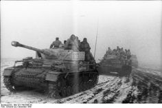 Panzer IVs of the 5th SS Panzer Division Wiking travel through snowy conditions along a road in southern Russia, 30 November 1943