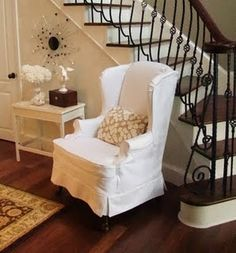 Great slipcover tutorial. Love the buttons down the back plus the zipper to make it fit well.
