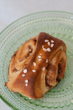 """Korvapuusti, unique Finnish cinnamon roll. The word """"Korvapuusti"""", based on my own experience, means the act of giving a kid a lesson by pulling their ear (to cause pain). I wouldn't be surprised if the recipe originally came here from Sweden. SM 