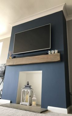 Lightly Worked Oak Mantelpiece with TV above, This design would pair with our Bailey high efficiency inset gas fire. Feature Wall Living Room, New Living Room, Home And Living, Living Room Decor, Tv On Wall Ideas Living Room, Living Room Lighting Uk, Blue Feature Wall, Bedroom Decor, Oak Beam Fireplace