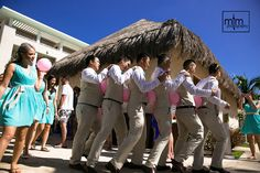 Groom & friends play balloon game in conga line style at Paradisus Playa del Carmen Resort MTM Photography in Mayan Riviera Wedding Photographer. Wedding Photographer photos in Cancun, Playa del Carmen, Puerto Morelos, Puerto Aventuras and Tulum. www.MomentsThatMatterPhotography.com