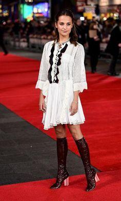 Alicia Vikander in a white Louis Vuitton babydoll dress