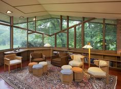 The glass panels throughout allow light to fill the living areas. - TownandCountrymag.com