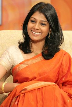Nandita Das: cream blouse with orange saree and the simple yet beautiful jewellery WOW