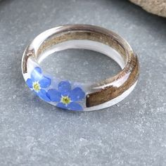 Another woodland ring from meltedglassbysteph with real homegrown forget me nots and bark