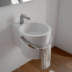 Round white ceramic wall mounted or vessel bathroom sink. Handle styled towel bar is included with sink. Stylish round over the counter or suspended sink has one pre drilled hole. Made in Italy by Scarabeo. Contemporary Bathroom Sinks, Bathroom Sink Design, Small Bathroom Sinks, Undermount Bathroom Sink, Modern Sink, Lavatory Sink, Faucet, Wall Mounted Bathroom Sinks, Wall Mounted Tv