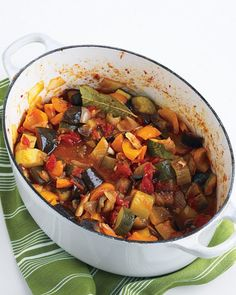 Ratatouille - Easy, delicious and rather cheap. This recipe makes a ton and pairs really well with the peasant bread recipe in our favorites.