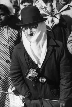 A man bundled against the cold during PRESIDENT JOHN F. KENNEDY's Inauguration.  -- January 20, 1961
