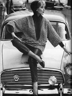 Model in houndstooth check tunic with deep v-neck and raglan sleeves worn over narrow trousers, photo by John French, 1960