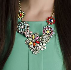 This beautiful Crystal Bloom Necklace is a must have addition to your jewelry collection.  Choose from two different styles - The Multicolored Crystal Bloom Necklace or a more classic Clear Crystal Bloom. Both are perfect for either a night out with an evening dress or to wear during the day with jeans and a shirt. It is truly a stunning design that will turn heads wherever you go.