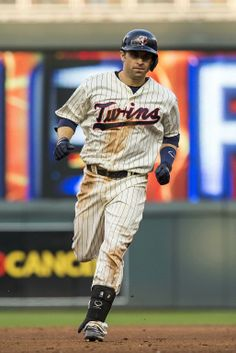 May 17, 2014; Minneapolis, MN, USA; Minnesota Twins second baseman Brian Dozier (2) rounds second base after hitting a three run home run in the fifth inning against the Seattle Mariners at Target Field. Mandatory Credit: Jesse Johnson-USA TODAY Sports