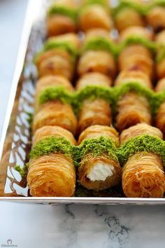 Creamy ricotta cheese wrapped inside golden, crunchy strands of sticky sweet kunafa. Lebanese Desserts, Lebanese Recipes, Turkish Recipes, Persian Recipes, Arabic Dessert, Arabic Sweets, Arabic Food, Kunafa Recipe, Middle Eastern Desserts