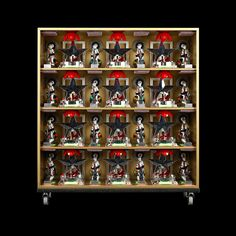 vertical pattern square gold I, 2009 / display cabinet, sundry objects – 102 x 102 x 25 cm.