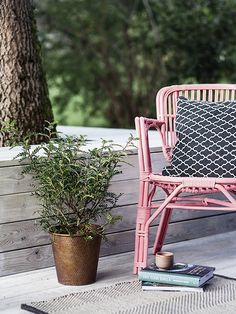 Add some fun colours to the porch to make it more interesting. Chair painted in color Milkshake from Alcro.