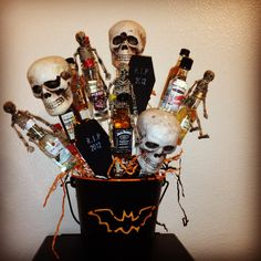 Halloween theme gift basket with mini bottles! Cost under 10$ to make plus alcohol!!!  Freddy got pretty creative!