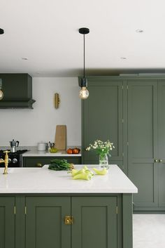 The Best in Dark Green Kitchen Trends - Town & Country Living - - According to several well-known home decor publications, shades of green are trending in the kitchen. Here are the best ideas in dark green kitchen trends. Devol Kitchens, Black Kitchens, Home Kitchens, Luxury Kitchens, Home Decor Kitchen, Kitchen Interior, New Kitchen, Kitchen Paint, Kitchen Ideas
