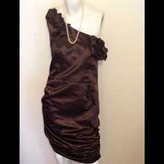 Cocktail/ Formal Dress Wow! Amazing for $30!!! Shiny, one shoulder chocolate brown dress. This gorgeous dress features rouching on both sides, which are amazingly flattering! The dress is accented with rosettes at the neck and on the shoulder. Size 16 Dresses Mini