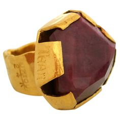 Henry Alvin Sharpe a High Carat Gold and Ruby Ring | Massive claw setting holding an unusaul shaped 82.55 corundum. H. Alvin Sharpe was a painter ,writer and sailor as well as self taught silversmith. His work is uniquely clever and bold.