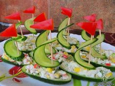 Cucumber boats, put chicken salad in the carved out boat, toothpick, slice of cucumber and watermelon make the sail