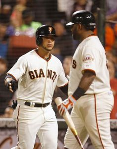 San Francisco Giants' Gregor Blanco, left is congratulated by Pablo Sandoval after scoring on a Buster Posey double against the San Diego Padres during the third inning of a baseball game in San Francisco, Thursday, Sept. 25, 2014. (AP Photo/Tony Avelar)