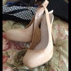 """Miu Miu sling backs Excellent used condition nude sling backs with a 1 inch platform. Heels are 4"""". There is minor wear on the sole but heels still look fantastic. Super sexy! Miu Miu Shoes Platforms"""