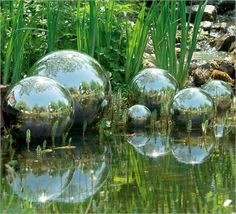 Gazing balls.....or faerie bubbles? Either way, these are eye candy for the water garden.