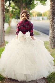 It would be cute to take a picture with one of your groom's flannels over you in your dress