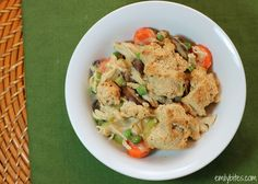 Chicken Pot Pie Casserole - hearty chicken and vegetables covered in a creamy, flavorful gravy and topped with crumbly biscuit pieces for just 303 calories or 8 Weight Watchers points per serving! www.emilybites.com #healthy