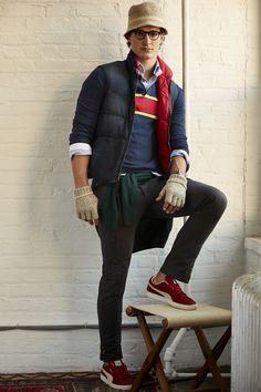 Look 11: Reversable down vest; fine gauge chest stripe 'rugby' pullover; blue oxford buttondown shirt; dark check blazer pant; bottle green cashmere V-neck sweater. Photo by Matt Albiani Model: Andrew Lenandowski