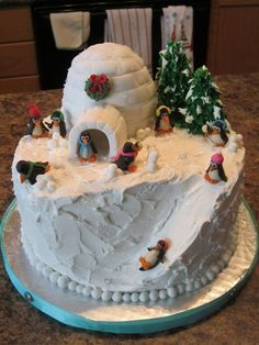 How cute is this!  Spiced cake with egg nog cream filling. Fondant igloo, RKT trees and modeling chocolate penguins.:  Cake decorating ideas