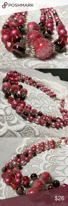 "Vintage pink, red and gold necklace Japan Gorgeous vintage three strand beaded necklace. Beads are pink, red and gold. One bead style is textured, faux pearls and Aurora Borealis.  Some of the textured beads have lost their texture.  Minor wear.  Short strand measures 17"" and long strand measures 20.5"". Vintage Jewelry Necklaces"