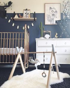 Such a dreamy, gender neutral nursery! Love the dark blue walls, and the fluffy faux fur rug adds beautiful texture!