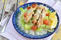 souvlaki met rijst en salade