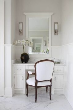 vanity with reupholstered white chair