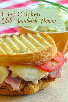 Fried Chicken Club Sandwich Panini - with apple fennel coleslaw! A beautifully crispy fried chicken breast served with leftover baked ham and cheese in an outstanding panini version of a southern club sandwich.
