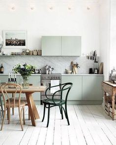 Mint green cabinets give this Scandi-chic kitchen a hint of playfulness. (: - Home Design Kitchen Desk Areas, Kitchen Desks, Home Decor Kitchen, Kitchen Furniture, Furniture Stores, Diy Kitchen, Furniture Shopping, Online Furniture, Green Kitchen Paint