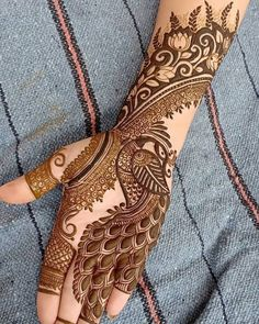 Mehndi henna designs are always searchable by Pakistani women and girls. Women, girls and also kids apply henna on their hands, feet and also on neck to look more gorgeous and traditional. Peacock Mehndi Designs, Latest Bridal Mehndi Designs, Indian Mehndi Designs, Full Hand Mehndi Designs, Latest Mehndi Designs, Henna Peacock, Mehandi Designs Modern, Palm Mehndi Design, Hena Designs