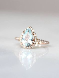 Aquamarine surrounded by petite diamonds. Need we say more? See more here: https://www.davieandchiyo.com/collections/diamond-alternative-engagement-rings/products/islene-ring