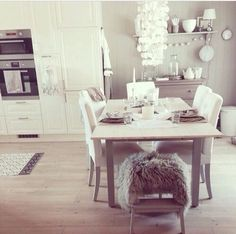 I love the white. And of course, that little fuzzy seat on the end of the table