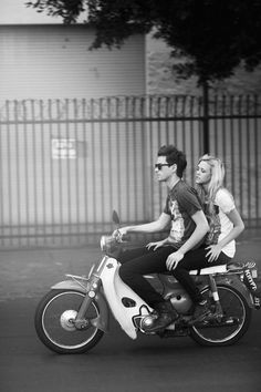awesome couple ride a motorcycle..it is honda 1970..damn
