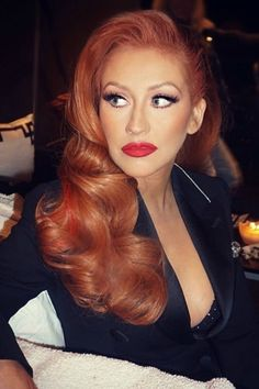 Christina Aguilera is giving us serious Jessica Rabbit vibes with her new red hair.