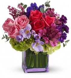 type of flowers I like - short, square container, lots of purple and green, full, variety for Valentine's Day - prefer this to a dozen roses