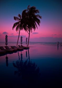 The infinity pool at Rangali Maidives in the dusking sky.