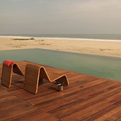 Hotel Escondido, Puerto Escondido,Mexico - pool and beach view with design chairs - Design Hotels™