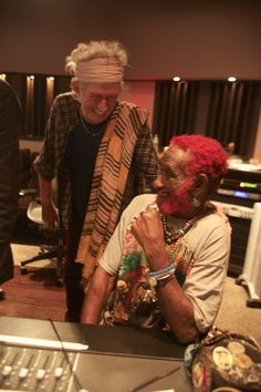 """Keith and Lee """"Scratch"""" Perry in the latest issue of Rolling Stone (the October 24, 2013 issue with the """"Walking Dead"""" on the cover). The pair are mixing a take on """"Love Is Overdue"""" by Gregory Isaacs."""